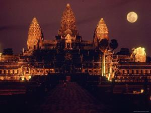 Full Moon over Angkor Wat Temple Ruins of Ancient Khmer Kingdom with Stupas Rising Above by Larry Burrows