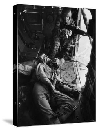 Helicopter Chief James C. Farley Working Jammed Machine as Pilot Lt. James Magel Dying Beside Him