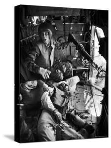 Helicopter Crew Chief James C. Farley Shouting to Crew as Wounded Comrades Lay Dying at His Feet by Larry Burrows