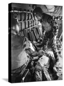 Helicopter Crew Chief James C. Farley with Wounded Pilot Lt. James Magel Lays Dying at His Feet by Larry Burrows