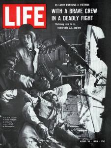 Helicopter Crew Chief James Farley Shouts to Crew as Pilot Lt Magel Dies Beside Him, April 16, 1965 by Larry Burrows