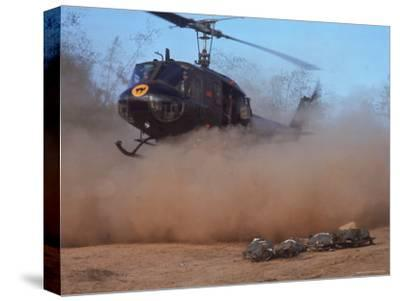 Helicopter Touching Down to Retrieve Bodies of Soldiers Killed in Firefight During the Vietnam War
