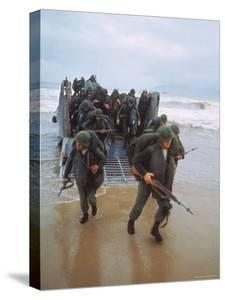 Marines of 9th Expeditionary Brigade Coming Ashore at Red Beach 2 by Larry Burrows