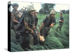 Marines Recovering Dead Comrade While under Fire During N. Vietnamese/Us Mil. Conflict by Larry Burrows
