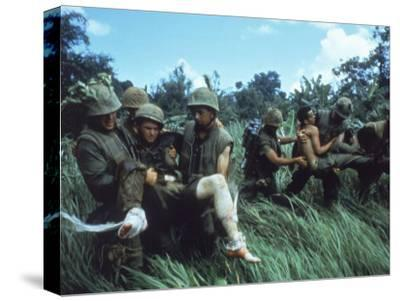 Members of 1st Marine Division Carrying Wounded During Firefight During Vietnam War. South Vietnam
