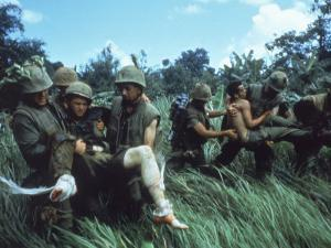 Members of 1st Marine Division Carrying Wounded During Firefight During Vietnam War. South Vietnam by Larry Burrows