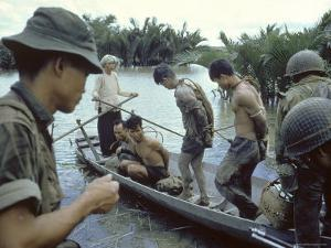 Nationalist S Vietnamese Soldiers Loading Viet Cong Prisoners Onto Canoe Like Boats in Mekong Delta by Larry Burrows