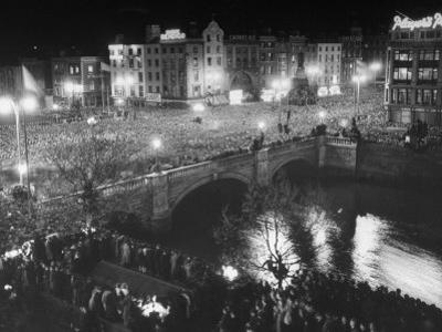 People Celebrating the Independence of Ireland on O'Connell Bridge before Midnight on Easter Sunday