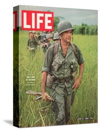 Soldiers Walking Through Grass in Vietnam, June 12, 1964