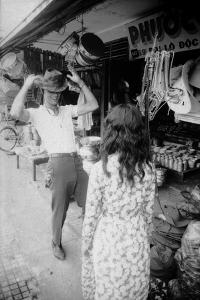 U.S Cpl. James C. Farley of Yankee Papa 13 Trying on Bush Hats, Danang, Vietnam 1965 by Larry Burrows
