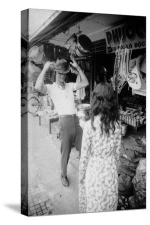 U.S Cpl. James C. Farley of Yankee Papa 13 Trying on Bush Hats, Danang, Vietnam 1965
