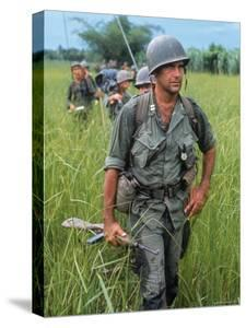 US Army Captain Robert Bacon Leading a Patrol During the Early Years of the Vietnam War by Larry Burrows