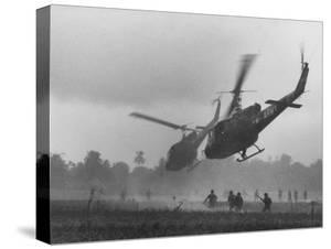 US Helicopters Carrying South Vietnamese Troops in Raid on Viet Cong Positions by Larry Burrows