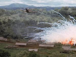 Village in flames after Explosives Dropped During an American Air Strike Against Viet Cong by Larry Burrows