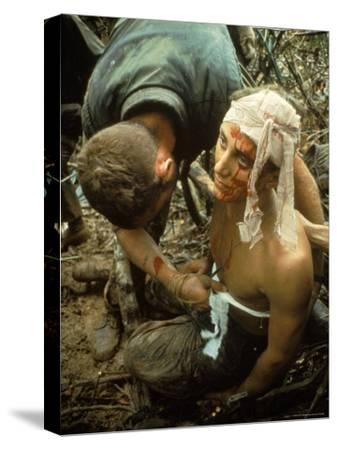 Wounded Marine Being Bandaged in Muddy Jungle During OP Prairie US Military Sweep South of DMZ