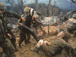 Wounded Marine Gunnery Sgt. Jeremiah Purdie During the Vietnam War by Larry Burrows