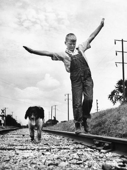 Larry Jim Holm with Dunk, His Spaniel Collie Mix, Walking Rail of Railroad Tracks in Rural Area-Myron Davis-Photographic Print