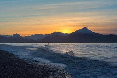 Surfer in Waves at Sunrise