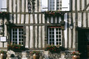 A Typical Traditional Timber Framed Building with Flowers in Window Boxes by LatitudeStock