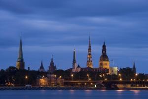 Latvia, Riga, Western Daugava River and Spires of Old Town, Illuminated at Night