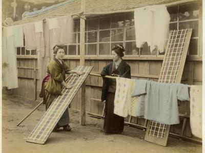 Laundry Day in Japan: Two Women Hang Up Clothes and Fabric to Dry Outdoors