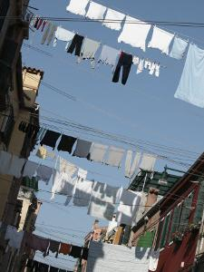 Laundry Hanging from Clotheslines Between Apartment Buildings