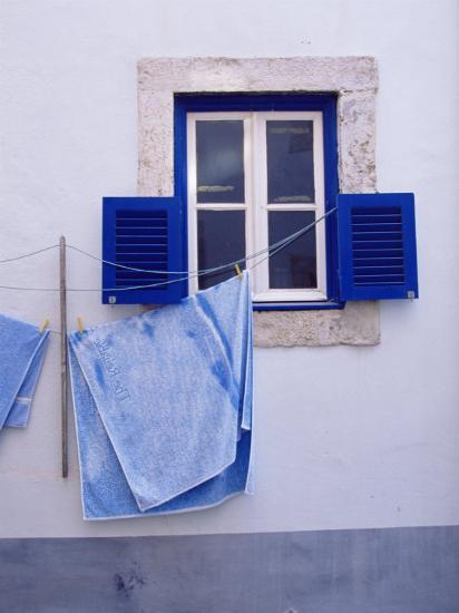 Laundry Hanging on Line at Window in the Moorish Quarter of Alfama, Lisbon, Portugal-Yadid Levy-Photographic Print