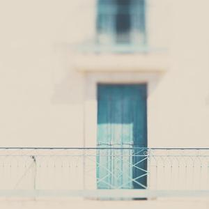 French Building with Balcony and Blue Door by Laura Evans