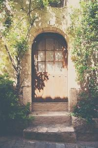 French Building with Doorway under Dappled Sunlight by Laura Evans