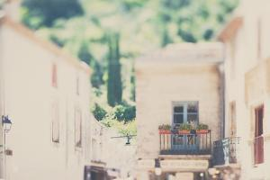 French Town Buildings in Summer with Balcony and Flowers by Laura Evans