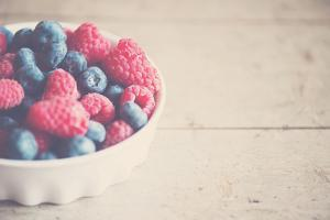 Fresh Ripe Blueberries with Pink Rapsberries by Laura Evans