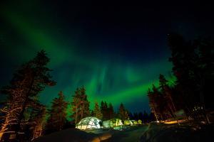Aurora Borealis (The Northern Lights) over Kakslauttanen Igloo West Village, Saariselka, Finland by Laura Grier