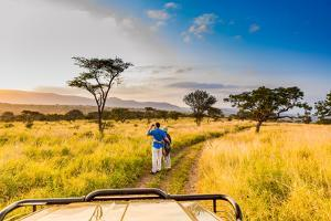 Couple enjoying view at a safari camp, Zululand, South Africa by Laura Grier