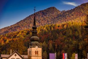 Fall foliage and scenic views in Vrsic Pass, Julian Alps, Slovenia, Europe by Laura Grier