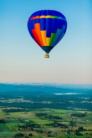Hot air balloon over Auburns farmland, Washington State, USA