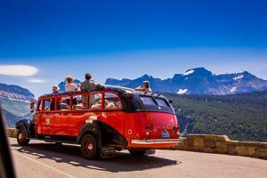 Vintage Tour Bus on the Sun Road, Glacier National Park, Montana by Laura Grier