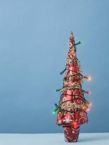 Christmas Tree with Lights and Blue Background by Laura Johansen