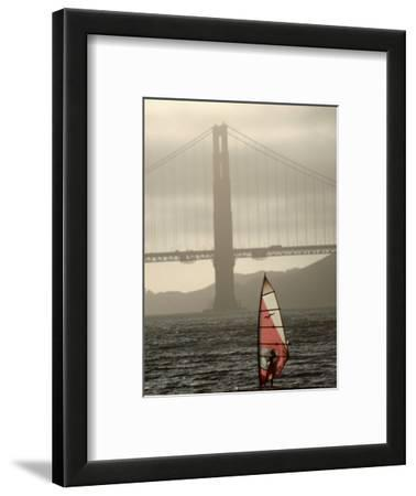 Windsurfer Sails Through Waters on San Francisco Bay, San Francisco, California, USA