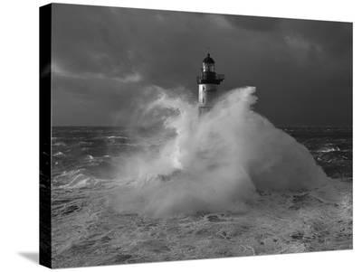 Le phare d'Ar-Men, lors d'un coup de vent-Jean Guichard-Stretched Canvas Print