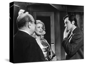 Le realisateur Jean-Pierre Melville, Catherine Deneuve and Alain Delon sur le tournage du film Un F