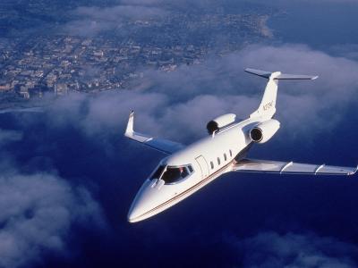 Lear Jet in Flight-Garry Adams-Photographic Print