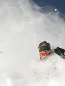 Skier in deep powder at Alta, Utah by Lee Cohen