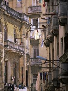Apartment Buildings with Laundry Hanging from Balconies, Havana, Cuba, West Indies, Central America by Lee Frost