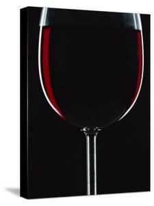 Backlit Shot of a Glass of Red Wine by Lee Frost