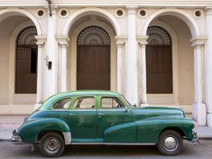Classic Green American Car Parked Outside the National Ballet School, Havana, Cuba by Lee Frost