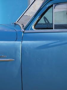 Detail of Vintage Blue American Car Against Painted Blue Wall by Lee Frost
