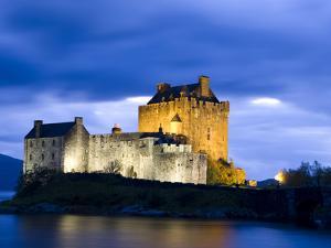 Eilean Donan Castle Floodlit Against Deep Blue Twilight Sky and Water of Loch Duich, Near Dornie, K by Lee Frost