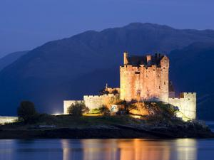 Eilean Donan Castle Floodlit at Night on Loch Duich, Near Kyle of Lochalsh, Highland by Lee Frost