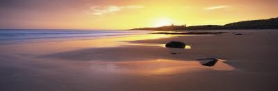 Embleton Bay at Sunrise, Dunstanburgh Castle in the Distance, Near Alwick, Northumberland, England