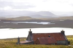 Farmhouse with Red Iron Roof Overlooking Lochs and Mountains Off the A858 South of Carloway by Lee Frost